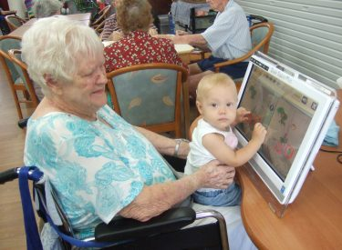 SocialImagesViolet_Oliver,_Lyn_Bradfords'_granddaughter_Caitlin_playing_Brain_Trainer